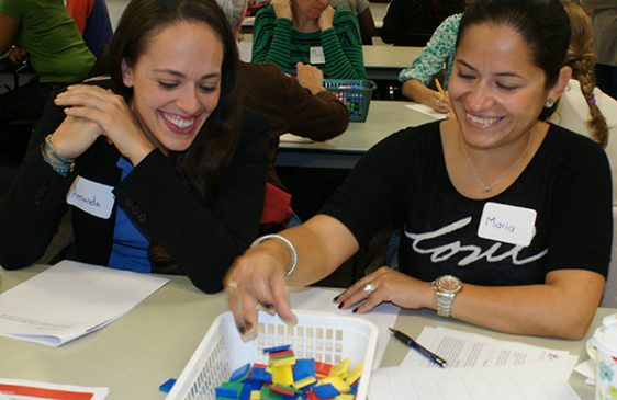 Two women working on a math problem