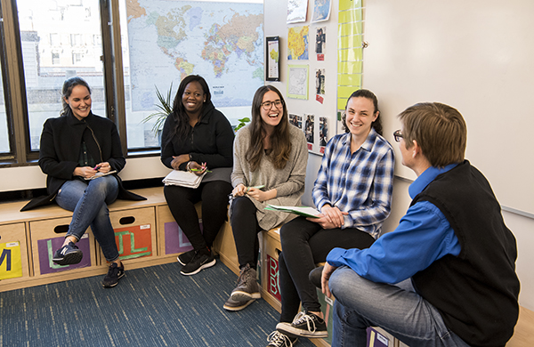 Five graduate students participating in conference group