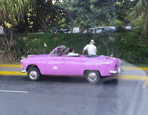 A Cuban taxi in front of the hotel