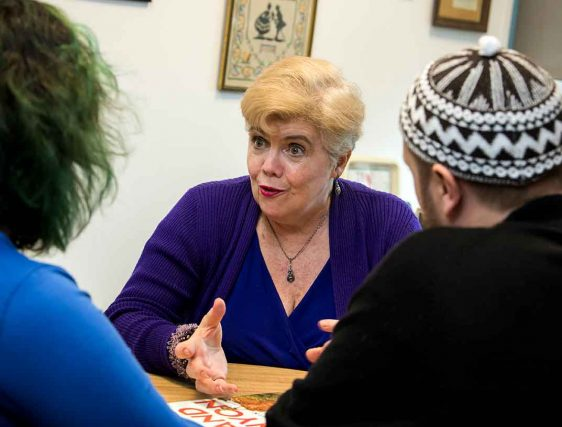 Professor Peggy McNamara meeting with students
