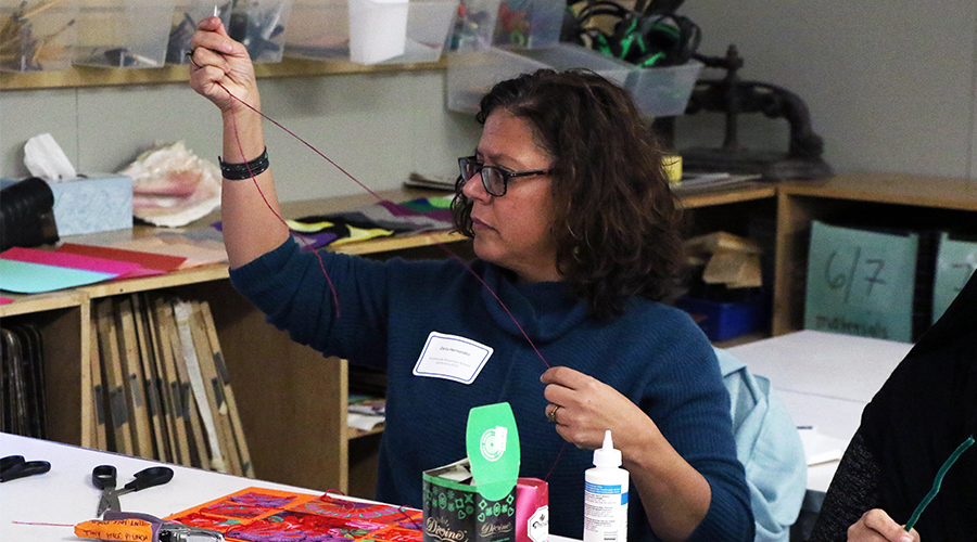 Educator uses string during an art activity at ERP conference