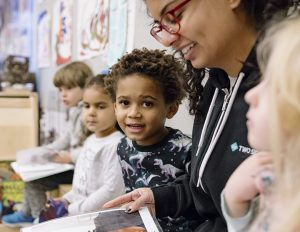 Teacher reads to young children