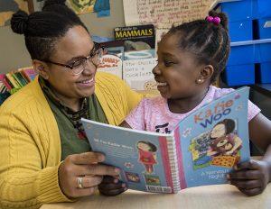Child and teacher reading