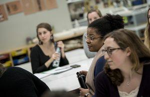 Graduate students listen during class
