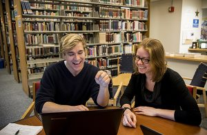 Two graduate students in the library