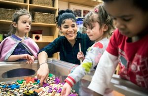 Teacher with young kids at sensory table