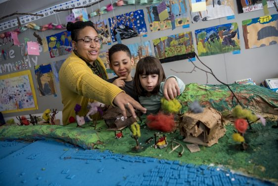 Teacher and two students explore the Hudson River model