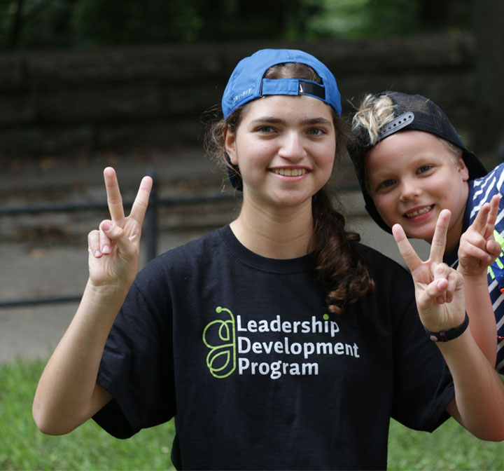 Leadership Development Program Camper giving peace sign