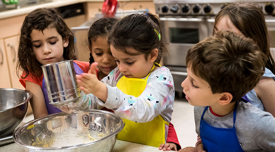 Kindergarten students learn math while making whoopie pies