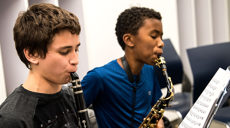 Upper School students take music lessons