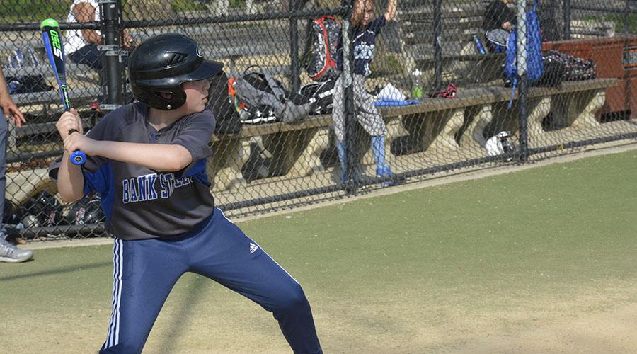 Child swinging softball bat