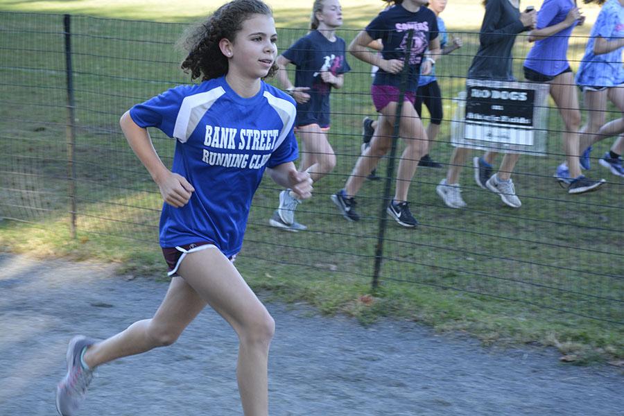 Child running in running club