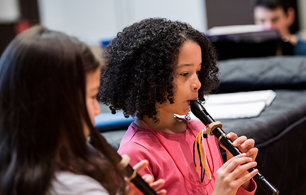 Child playing the clarinet