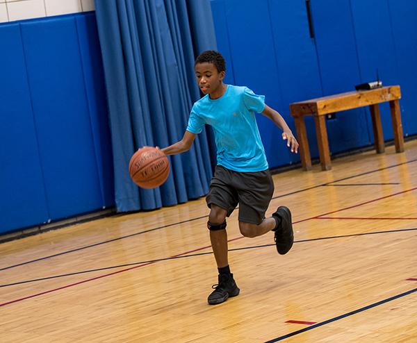 8/9s student dribbling basketball