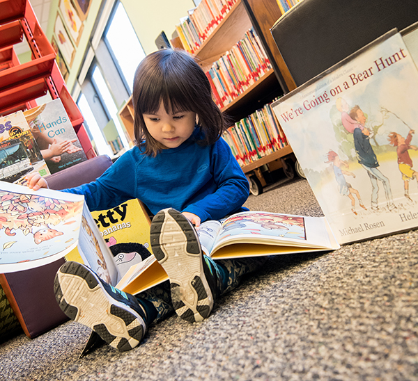 3/4s child reading in library