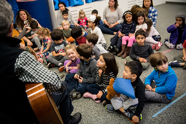 Lower School students listening to guitar player