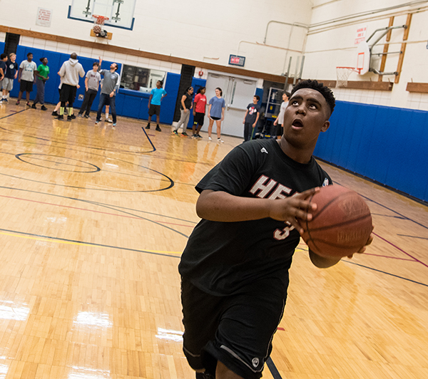 Upper School student holding basketball
