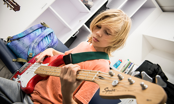 Upper School student playing guitar