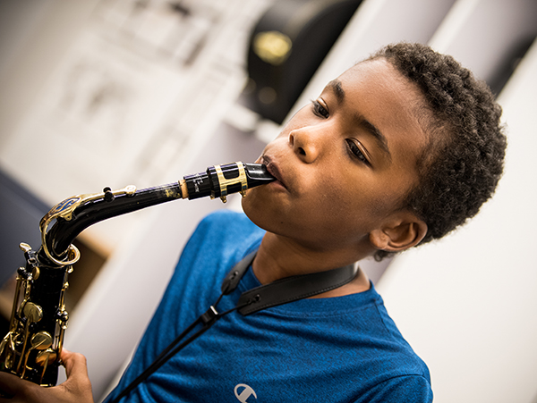 11/12s student playing saxophone