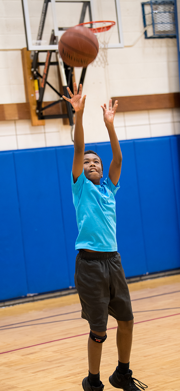 Student shooting a basketball