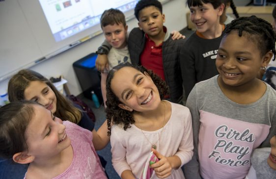 Group of Middle School students smiling