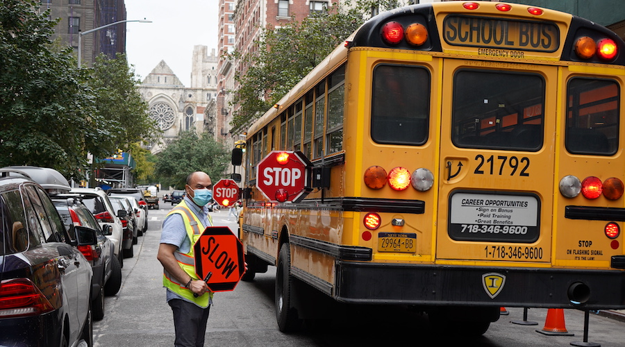 Security guard guides Bank Street school bus