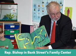 Tim Bishop reads to children in Bank Street's family center