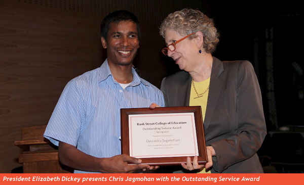 Elisabeth Dickey presents Chris Jagmohan with the Outstanding Service Award