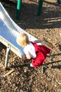 Figure 4. Towheaded toddler on slide