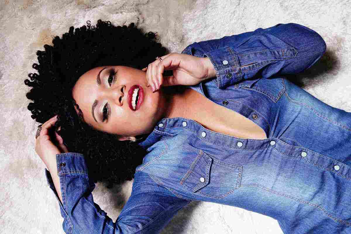 Afro woman in denim