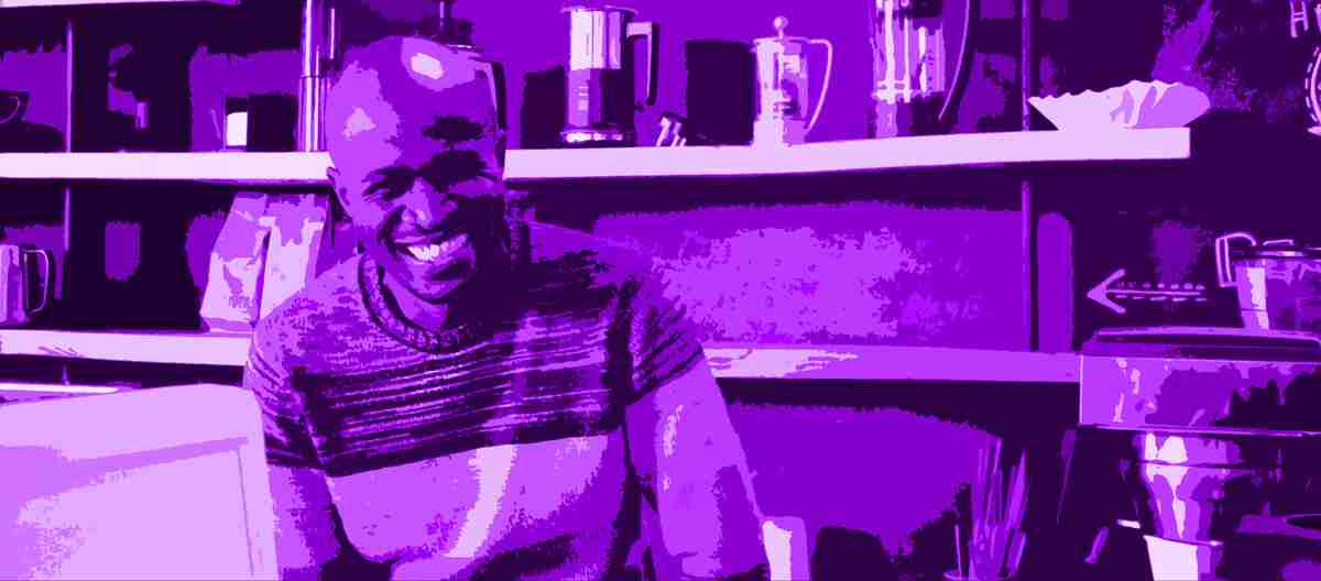 Black man smiling - purple overlay