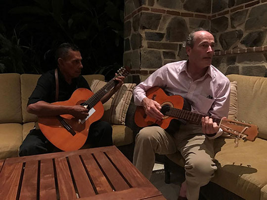 "Bill plays the guitar with Jorgelito, the resident ""cantante"" at Rancho Santana"