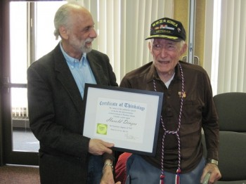 "Harold Dinzes (right) receives ""DTH"" from Arnold Kortkin"