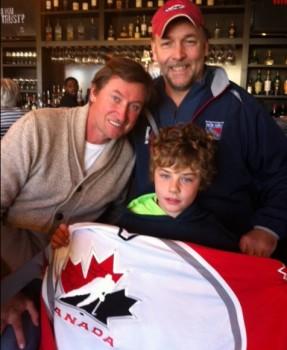 "Bob Severance and  Jack Severance, a junior hockey payer - holding a ""Team Canada"" jersey."