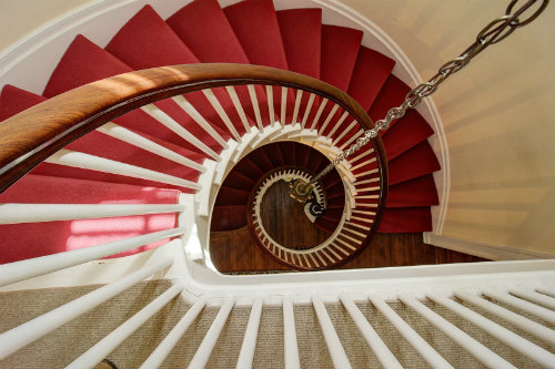 Carmen Berra fell in love with the house because of details like this fabulous staircase.