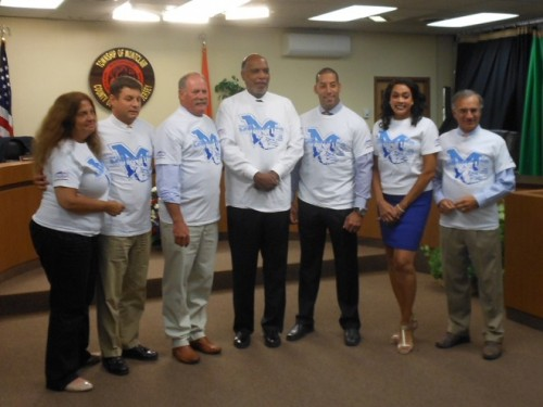Montclair Mayor Robert Jackson (center) and the Montclair Township Council show their Mounties pride for the start of the high school football season.