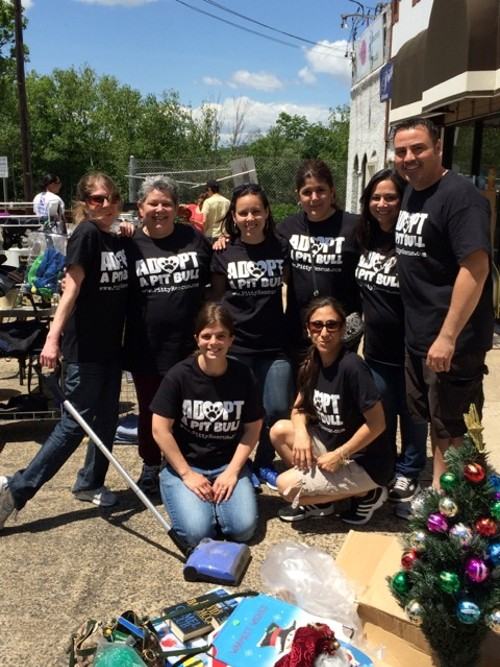 Pitty Rescue, Inc. volunteers working at the garage sale in May 2014, which netted over $2,400 with all proceeds going towards the dogs.  Pitty Rescue Fall Yard Sale will take place at Paradise Pets in Bloomfield on September 27 and 28 from 9 am to 3 pm.