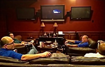 Members talk and smoke their cigars in Fumé's Lounge.