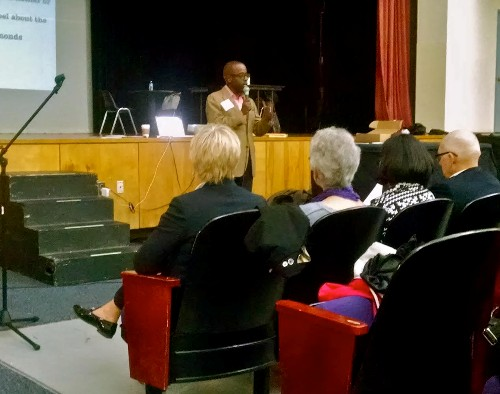 Panel chair Jonathan Simon addresses parents at second community forum held by AGAP.