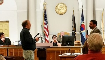 Resident Geoff Gove questions applicant's traffic expert at Tuesday evening's meeting.