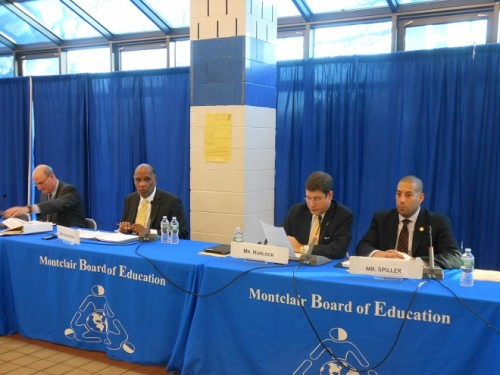 The Montclair Board of School Estimate - from left, Board of Education (BOE) President David Deutsch, Mayor Robert Jackson, and Councilors William Hurlock (reading the meeting notice statement) and Sean Spiller.  BOE representative Anne Mernin was absent.
