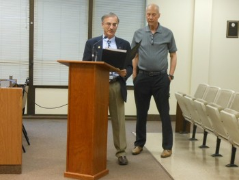 Deputy Mayor Robert Russo reads the proclamation honoring New Jersey public television journalist Michael Aron, standing at right.