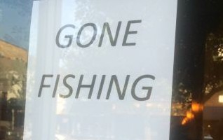 The sign on the front door of Blu.
