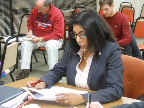 Montclair Chief Financial Officer Padmaja Rao delivers news on the reduced debt at the November 24 Montclair Township Council meeting while resident Sandy Sorkin (left) takes notes.