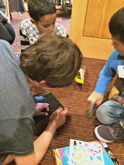 Syrian refugee children play with Bnai Keshet's Sam Tepperman.