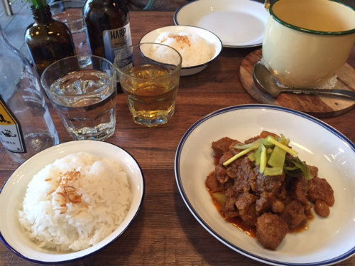 Pork belly with curry, ginger and garlic pickle, served with rice.