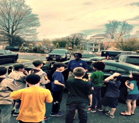 (Officer Anjannette Johnson shows Boy Scouts a Patrol Car)