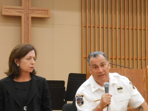 Montclair Police Chief Todd Conforti addresses a question at the police forum at the Salvation Army church while Essex County Acting Prosecutor Carolyn Murray listens.