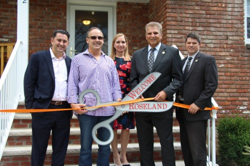 Pictured (L-R): Ben Proce, Member of The Arc of Essex County Board of Directors and Partner, PwC; John Duthie, Mayor of Roseland; Linda Lucas, CEO of The Arc of Essex County; Joe DiVincenzo, Essex County Executive; George Serio, Jr., Director of the Essex County Division of Housing and Community Development. Essex County Executive Joe DiVincenzo, John Duthie, Mayor of Roseland, and George Serio, Jr., Director of the Essex County Division of Housing and Community Development join The Arc of Essex County's CEO Linda Lucas and member of the Board of Directors and Partner at PwC Ben Proce for the ribbon cutting ceremony of The Arc's newest group home in Roseland. Essex County, the Townships of Roseland, and PwC, along with the NJ Division of Developmental Disabilities, Catholic Human Services, and Ralph M. Cestone Foundation contributed funds towards the acquisition, renovations, and furnishings of the new group home.