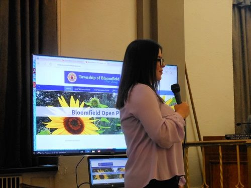 Bloomfield Township intern Maria Hurtado explains improvements to the town's public-records site to the council.